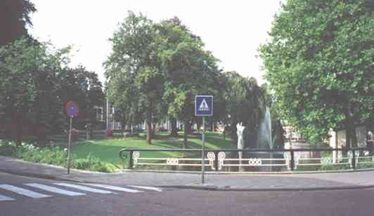 town picture of tiel, crosswalk, fountain, road canal, bridge and trees